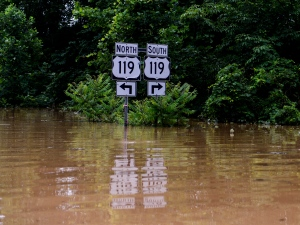 Road signs signaling to US 119 along Frame Road in Elkview, W.Va., are surrounded by flood waters Friday, June 24, 2016. (Sam Owens / Charleston Gazette-Mail via AP)