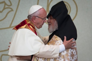 Pope Francis, left, embraces Catholicos Karekin II during an Ecumenical encounter and prayer for Peace at the Republic Square in Yereven, Armenia, Saturday, June 25, 2016. (AP / Alexander Zemlianichenko)