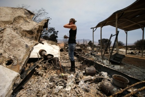 Amy Nelson, 30, breaks down as she goes through the remains of her home devastated by a wildfire, Saturday, June 25, 2016, in South Lake, Calif. (AP / Jae C. Hong)