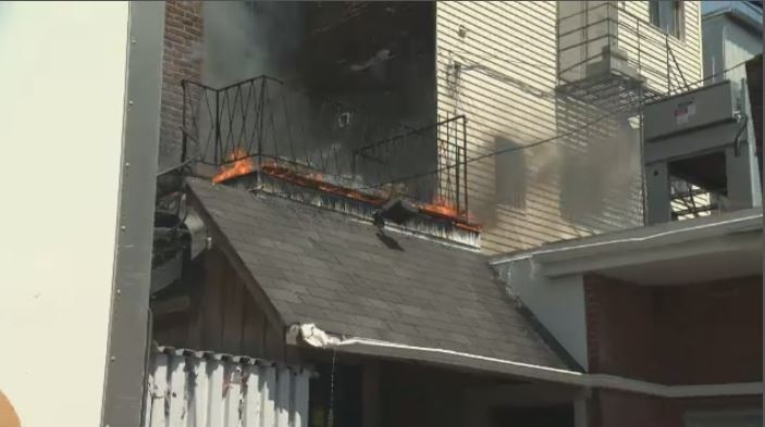 This Montreal fire started in a flower planter on a second-floor balcony behind a store.
