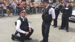 A Metropolitan Police Service officer proposes to another officer during London's Pride Parade on June 25, 2016. (MET LGBT Network via Twitter)