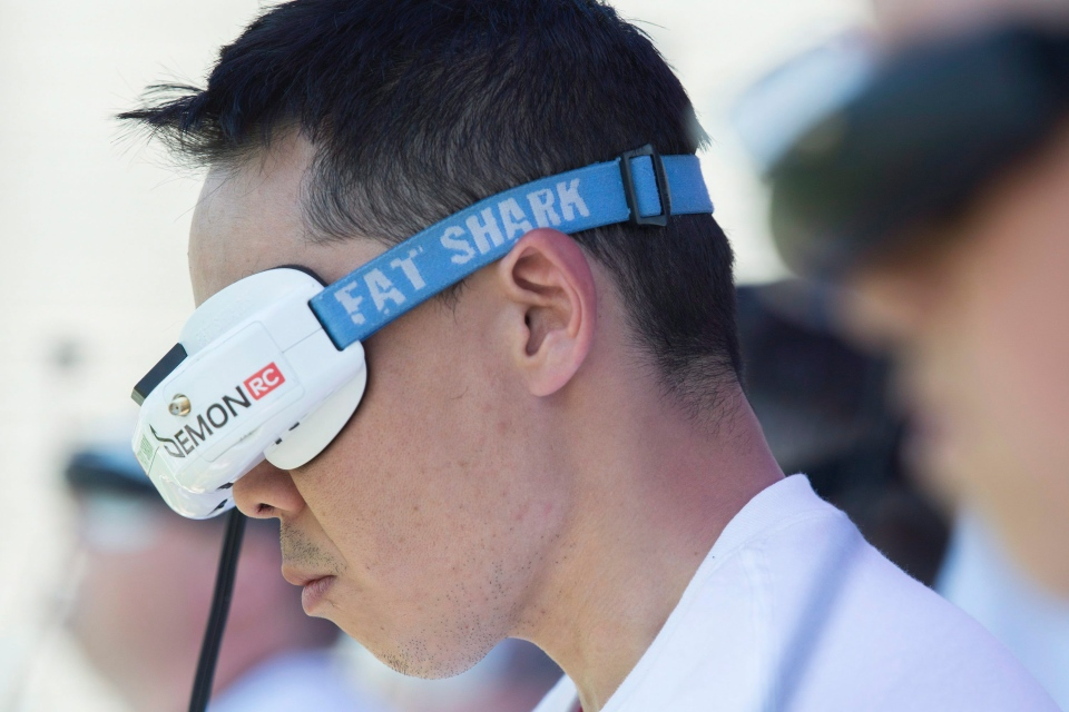 Pilots wear virtual headsets as they compete during the Montreal drone expo, Saturday, June 25, 2016. (Graham Hughes/The Canadian Press)