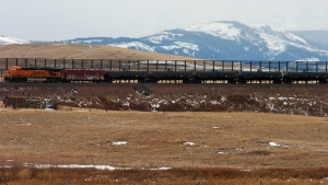 In this Nov. 7, 2013 file photo, a train hauls oil into Glacier National Park near the Badger-Two Medicine National Forest in northwest Montana. Companies proposing to build the nation's largest oil-by-rail marine terminal in southwest Washington state and their foes will argue their cases before a state energy panel in Vancouver, Wash., on Monday, June 27, 2016. (Matthew Brown, File/AP Photo)