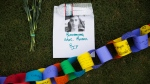In this June 13, 2016 file photo, a remembrance to Eric Rivera who was killed in the mass shooting at the Pulse nightclub sits amongst a makeshift memorial to the all the victims, in Orlando, Fla. (AP / David Goldman, FILE)