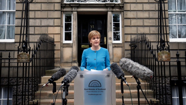 First Minister Nicola Sturgeon speaks to the media outside Bute House, following an emergency Scottish cabinet meeting in Edinburgh, Scotland, Saturday, June 25, 2016. (Jane Barlow/PA via AP)
