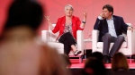 MPs, from left, Patty Hajdu speaks as Dominic LeBlanc listens in at the Rights and Equality: Social Policy in 2016 workshop onstage at the 2016 Liberal Biennial Convention in Winnipeg, Friday, May 27, 2016. (THE CANADIAN PRESS/John Woods)