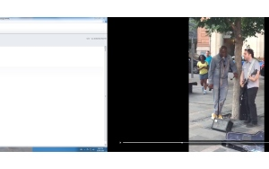 In this screengrab from a video posted to Twitter, Seal is seen performing a duet with a Montreal busker. (Neil St. Clair/Twitter)