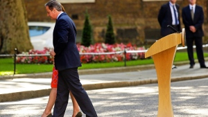 In this Friday, June 24, 2016 file photo, Britain's Prime Minister David Cameron and his wife Samantha walk back into 10 Downing Street, London, after speaking to the media (AP / Matt Dunham, File)