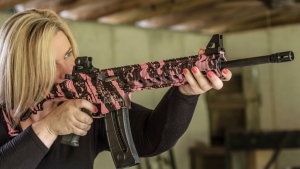 Dara Humphries, an NRA and Glock firearms instructor, poses for a portrait in Gainesville, Ga., holding an AR-platform rifle at a gun range on June 24, 2016. (AP / Lisa Marie Pane)