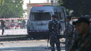 Lebanese policemen stand guard around a damaged ambulance in Qaa, eastern Lebanon, on June 27, 2016. (AP)