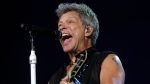 "In this Sept. 11, 2015 file photo, Bon Jovi's lead singer Jon Bon Jovi performs during their ""Bon Jovi Live!"" concert at Gelora Bung Karno Stadium in Jakarta, Indonesia, on their Asia tour. (AP Photo/Tatan Syuflana)"