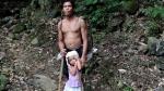 Blind coconut farmer Nelson 'Dodong' Pepe is shown with his daughter, Jenny, in the Philippines. (Rhuby Capunes / Facebook)