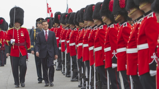 Mexico's President Enrique Pena Nieto inspects during military ceremony in Quebec City Monday, June 27, 2016. (Clement Allard / THE CANADIAN PRESS)