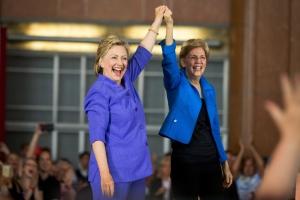Democratic presidential candidate Hillary Clinton, accompanied by Sen. Elizabeth Warren, D-Mass., arrives to speak at the Cincinnati Museum Center at Union Terminal in Cincinnati, Monday, June 27, 2016. (AP Photo/Andrew Harnik)