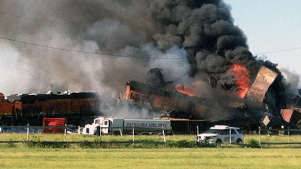 In this photo provided by Billy B. Brown, two freight trains are on fire Tuesday, June 28, 2016, after they collided and derailed near Panhandle, Texas. (Billy B. Brown via AP)