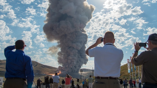 Spectators watch the second and final qualification motor (QM-2) test for the Space Launch System's booster, Tuesday, June 28, 2016, at Orbital ATK Propulsion Systems test facilities in Promontory, Utah. (Bill Ingalls/NASA via AP)