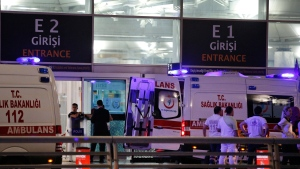Rescue services gather outside Istanbul's Ataturk airport, Tuesday, June 28, 2016. Two explosions have rocked Istanbul's Ataturk airport, killing several people and wounding others, Turkey's justice minister and another official said Tuesday.  (AP / Emrah Gurel)