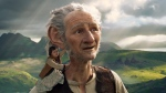 This image released by Disney shows Ruby Barnhill and the Big Friendly Giant from Giant Country, voiced by Mark Rylance, in a scene from 'The BFG.' (Disney via AP)