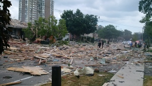 Debris litters a street after a house explosion in Mississauga, Ont., Tuesday, June 28, 2016. (Zeljko Zidaric / THE CANADIAN PRESS)