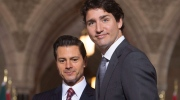 Canadian Prime Minister Justin Trudeau (right) looks to the cameras as he leaves a signing ceremony with Mexican President Enrique Pena Nieto on Parliament Hill in Ottawa, Tuesday, June 28, 2016. THE CANADIAN PRESS/Adrian Wyld