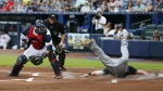 Cleveland Indians' Jason Kipnis scores ahead of the throw to Atlanta Braves catcher A.J. Pierzynski on a Jose Ramirez base hit in the first inning of a baseball game in Atlanta on Tuesday, June 28, 2016. (AP / John Bazemore)