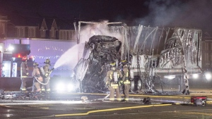 Firefighters attend the scene of a multi-vehicle crash in Toronto on June 24, 2016. (Victor Biro / THE CANADIAN PRESS)