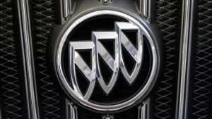 A Buick logo on the grill of a 2013 Regal at the Pittsburgh Auto Show, in Pittsburgh, on Feb. 14, 2013. (Gene J. Puskar / AP)