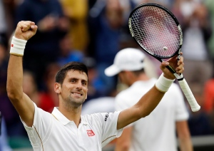 Novak Djokovic of Serbia celebrates after beating Adrian Mannarino of France in their men's singles match on day three of the Wimbledon Tennis Championships in London, Wednesday, June 29, 2016. (AP / Ben Curtis)