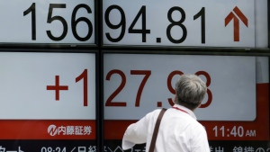 A man looks at an electronic stock board showing Japan's Nikkei 225 index at a securities firm in Tokyo on Thursday, June 30, 2016. (AP / Eugene Hoshiko)
