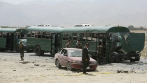 Afghan security forces inspect the site of a suicide attack on the outskirts of Kabul, Afghanistan on Thursday, June 30, 2016. (AP / Rahmat Gul)