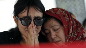 Mourners react next to the coffin during the funeral for Gulsen Bahadir, 28, a Turkish Airlines (THY) flight attendant killed Tuesday at the blasts at Ataturk airport, in Istanbul on Wednesday, June 29, 2016. (AP / Emrah Gurel)