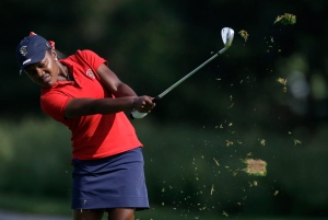 United States' Mariah Stackhouse hits her approach shot to the fifth green during the 38th Curtis Cup amateur golf match against Great Britain and Ireland  in St. Louis on Friday, June 6, 2014. (AP / Jeff Roberson)