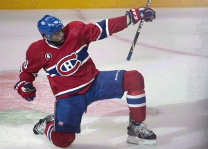Montreal Canadiens' P.K. Subban celebrates his goal past Ottawa Senators goalie Andrew Hammond during second period of Game 2 NHL Stanley Cup first round playoff hockey action April 17, 2015 in Montreal. (Paul Chiasson / THE CANADIAN PRESS)