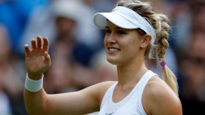 Eugenie Bouchard of Canada celebrates after beating Johanna Konta of Britain ion day four of the Wimbledon Tennis Championships in London, Thursday, June 30, 2016. (AP Photo/Alastair Grant)