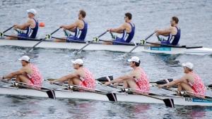 Russian (bottom) and Estonian boats race during a men's quadruple rowing sculls heat in Eton Dorney, near Windsor, England, at the 2012 Summer Olympics, Saturday, July 28, 2012. (Natacha Pisarenko/AP Photo)