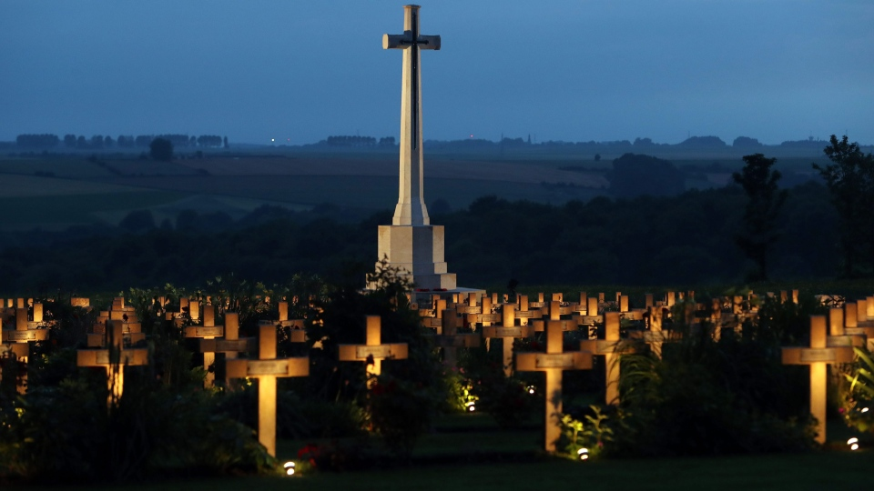 War graves are lit during a military-led vigil on the eve of the centenary of the Battle of the Somme at the Thiepval Memorial in France, where 70,000 British and Commonwealth soldiers are commemorated, Thursday June 30, 2016. (Steve Parsons/Pool via AP)