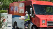 A Canada Post employee fills a community mail box in Dartmouth, N.S. on Thursday, June 30, 2016. Canada Post and the Canadian Union of Postal Workers have been in negotiations since December for its 50,000 delivery and plant employees. The workers are in a legal strike or lockout position as of Saturday if an agreement isn't reached. THE CANADIAN PRESS/Andrew Vaughan