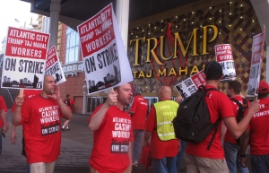 Union members picket outside the Trump Taj Mahal casino in Atlantic City N.J. on Friday July 1, 2016, moments after they began a strike against the casino. Local 54 of the Unite-HERE union says it was unable to reach a new contract with the casino, which is owned by billionaire investor Carl Icahn. (AP Photo/Wayne Parry)