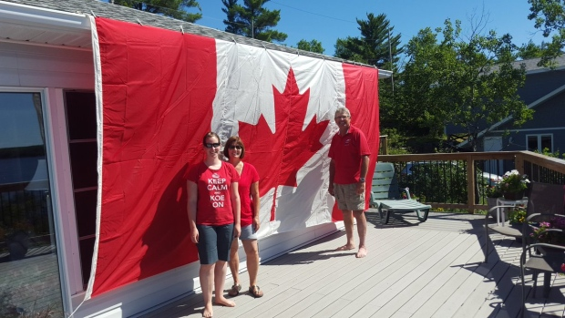Happy Canada from Falcon Lake @ctvnews #ctvcanadaday #peacetowerflag. (Twitter / @prairieheart)
