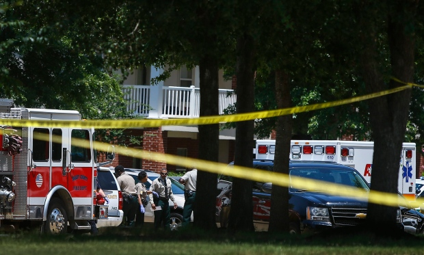 Shelby County Sheriff's deputies work the scene where four young children were fatally stabbed at the Greens of Irene apartment, Friday, July 1, 2016 in Memphis, Tenn. (Mark Weber / The Commercial Appeal via AP)