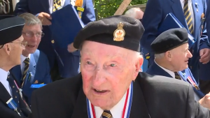 Charles Moores, a member of the Merchant Marine, recalled some of his harrowing experiences from the war.