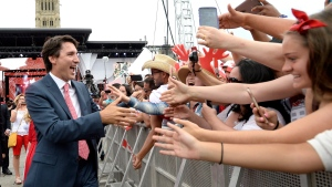 Prime Minister Justin Trudeau greets attendees following Canada Day celebrations on Parliament Hill, in Ottawa on Friday, July 1, 2016. THE CANADIAN PRESS/Justin Tang