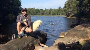 Drew Czernik poses for a photo on Tonakela Lake, in Algonquin Park, Ont.