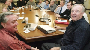 Liberal Leader Paul Martin (right) holds a meeting with head of his transition team, Mike Robinson (left), in Ottawa, on Friday November 21, 2003. Mike Robinson died in Normandy, France. He was 67. (THE CANADIAN PRESS/ Fred Chartrand)