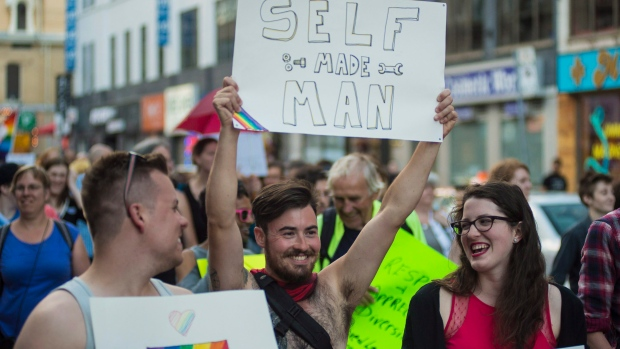 People participate in the Trans Pride March, in Toronto, on Friday, July 1, 2016. (THE CANADIAN PRESS/Eduardo Lima)