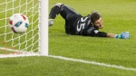 Toronto FC's goalkeeper Alex Bono dives for a ball that narrowly misses the goal during second half MLS soccer action against the Seattle Sounders FC, in Toronto on Saturday, July 2, 2016. THE CANADIAN PRESS/Mark Blinch