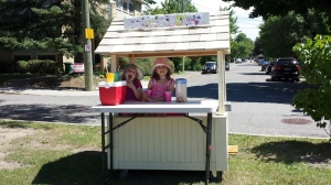 Eliza Andrews, 7, and sister Adela, 5, were selling lemonade in Ottawa on Sunday until a National Capital Commission official shut down their stand because they didn't have the right permit. (Kurtis Andrews / provided)