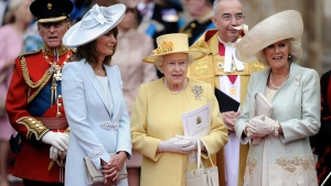 From left, Prince Phillip, Carole Middleton, Britain's Queen Elizabeth II and Camilla, Duchess of Cornwall stand outside of Westminster Abbey after the Royal Wedding in London Friday, April, 29, 2011. (AP Photo/Martin Meissner)