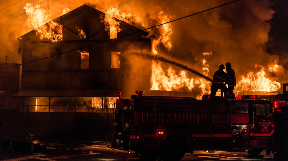 Crews battle a massive fire at the Cassidy Inn Pub in Nanaimo after it went up in flames overnight Monday, July 4, 2016. (Courtesy Nick Boyle Photography)