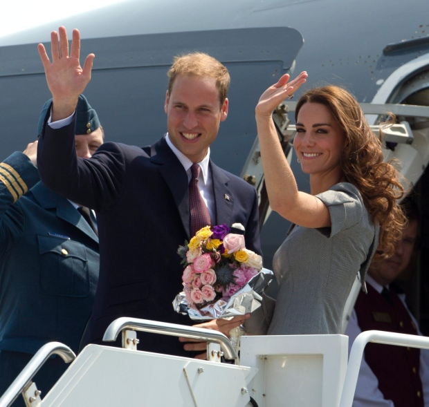 Prince William and Kate, the Duke and Duchess of Cambridge, wave as they board their plane as they leave Ottawa, en route to Montreal as they continue their Royal Tour of Canada Saturday, July 2, 2011. (AP / Charlie Riedel)